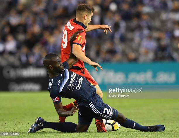Jason Geria of the Victory tackles Ben Garuccio of Adelaide United during the round 10 ALeague match between the Melbourne Victory and Adelaide...