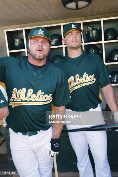 Jason Giambi and Matt Holliday of the Oakland Athletics in the dugout prior to the game against the Milwaukee Brewers at the Phoenix Municpal Stadium...