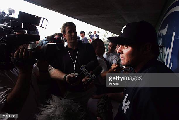 Jason Giambi of the New York Yankees answers questions from the media during batting practice before the preseason game against the Boston Red Sox on...