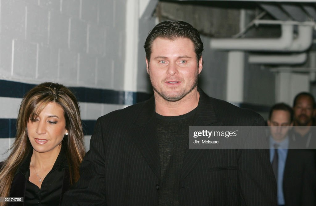 Jason Giambi of the New York Yankees arrives with his wife Kristian at his press conference to discuss his alleged steroid use on February 10, 2005 at Yankee Stadium in Bronx borough of New York City.