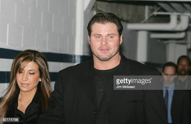 Jason Giambi of the New York Yankees arrives with his wife Kristian at his press conference to discuss his alleged steroid use on February 10 2005 at...