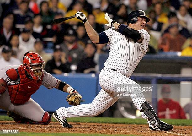 Jason Giambi of the New York Yankees hits a RBI in the fourth inning against the Los Angeles Angels of Anaheim during Game Three of the American...