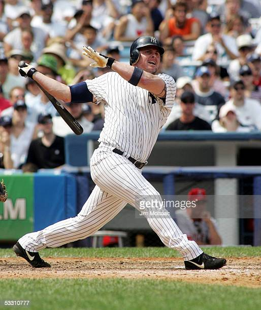 Jason Giambi of the New York Yankees hits his 300th career home run in the seventh inning against the Los Angeles Angels of Anaheim on July 31, 2005...