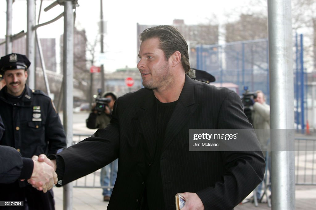 Jason Giambi of the New York Yankees shakes hands with a police officer as he arrives at his press conference to discuss his alleged steroid use on February 10, 2005 at Yankee Stadium in Bronx borough of New York City.