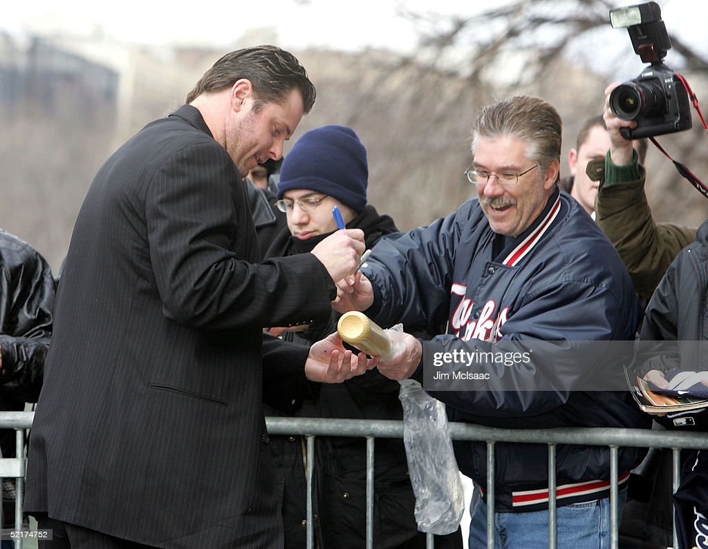 Jason Giambi of the New York Yankees signs autographs for fans as he arrives at his press conference to discuss his alleged steroid use on February 10, 2005 at Yankee Stadium in Bronx borough of New York City.