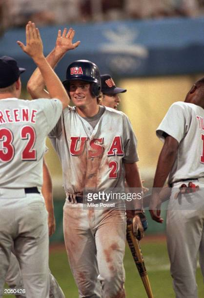 Jason Giambi of the United States gives a high five during the Olympic baseball game against Cuba at the Olympic Baseball Stadium in Barcelona Spain...