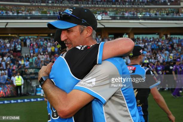 Jason Gillespie head coach of the Strikers embraces Michael Neser after winning the Big Bash League Final match between the Adelaide Strikers and the...