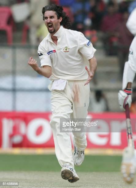 Jason Gillespie of Australia celebrates the wicket of Irfan Pathan of India during day five of the First Test between India and Australia played at...