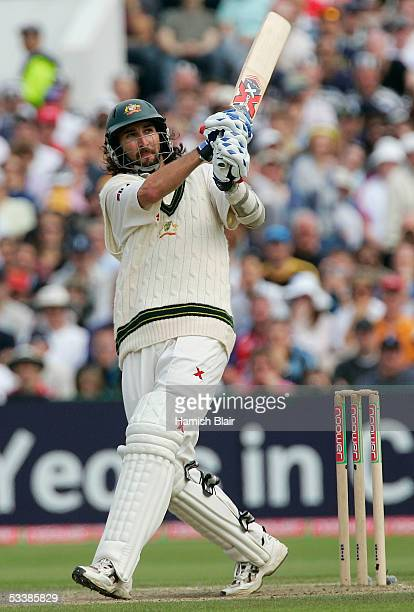 Jason Gillespie of Australia hits a six during day four of the Third npower Ashes Test between England and Australia played at Old Trafford on August...