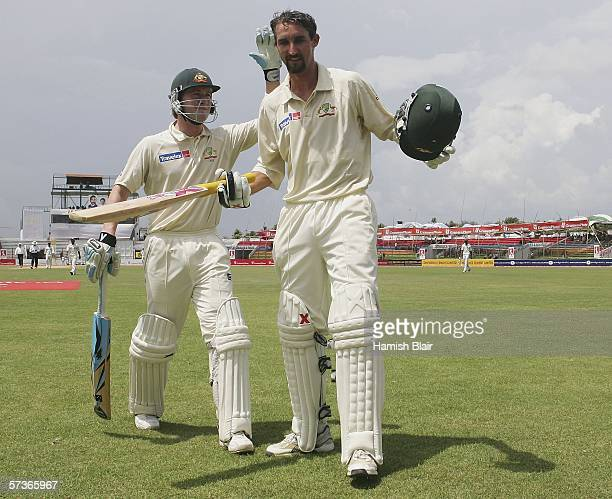 Jason Gillespie of Australia is congratulated on his double century by team mate Michael Clarke during day four of the Second Test between Bangladesh...