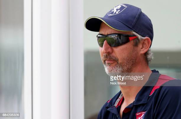 Jason Gillespie of Kent oberves the match action from the players balcony during the Royal London OneDay Cup between Kent and Essex at the Spitfire...