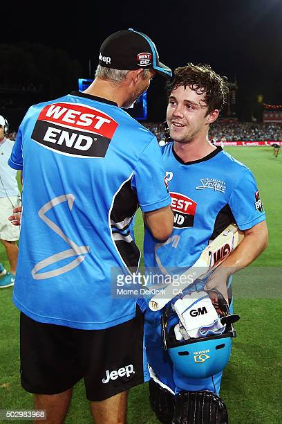 Jason Gillespie of the Adelaide Strikers congratulates Travis Head after the Big Bash League match between the Adelaide Strikers and the Sydney...