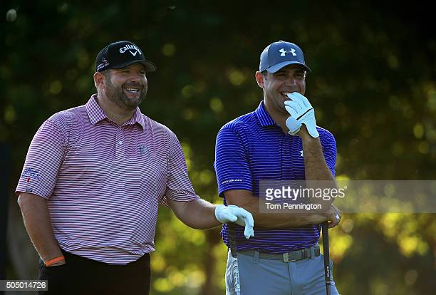 Jason Gore and Gary Woodland talk on the first tee during the first round of the Sony Open In Hawaii at Waialae Country Club on January 14 2016 in...