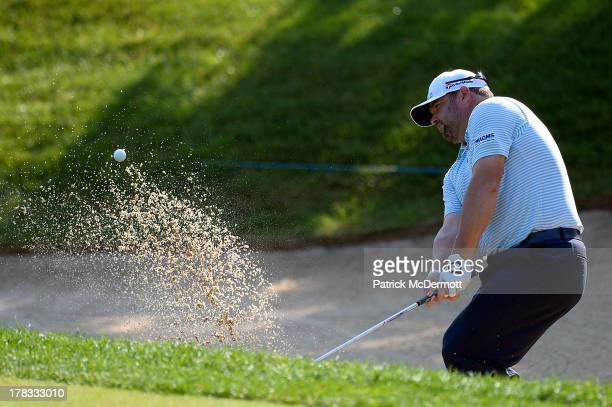 Jason Gore hits onto the seventh green from a bunker during round one of the 2013 Hotel Fitness Championship at Sycamore Hills Golf Club on August 29...