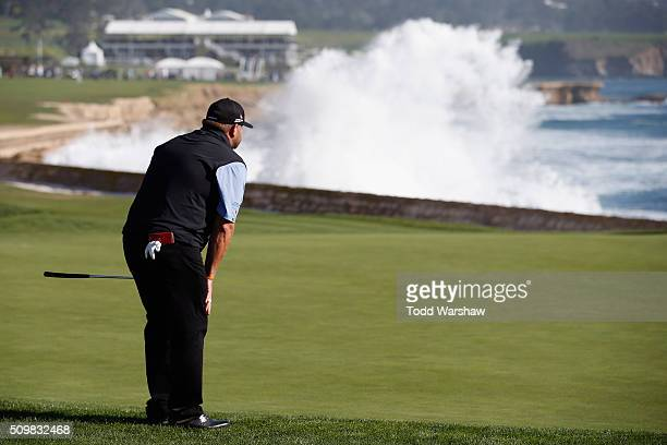 Jason Gore lines up a putt on the 18th green during the second round of the ATT Pebble Beach National ProAm at the Pebble Beach Golf Links on...