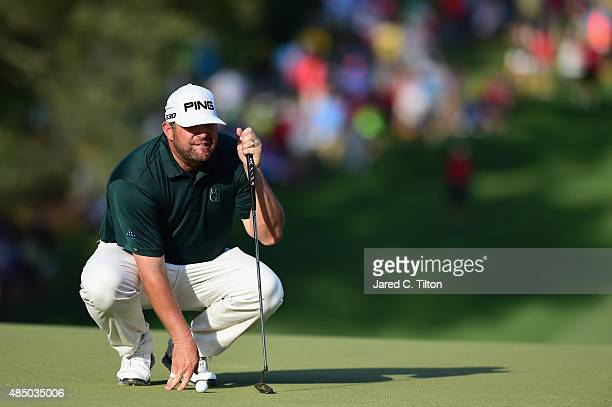 Jason Gore lines up his birdie putt on the 18th green during the final round of the Wyndham Championship at Sedgefield Country Club on August 23 2015...