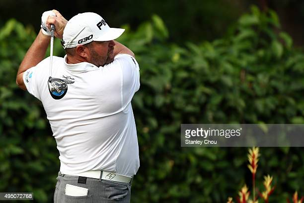 Jason Gore of the United States plays his tee shot on the 3rd hole during round three of the CIMB Classic at Kuala Lumpur Golf Country Club on...