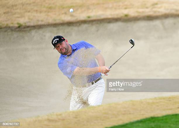 Jason Gore plays a shot from the bunker on the 11th hole during the second round of the CareerBuilder Challenge In Partnership With The Clinton...