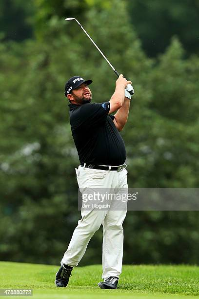 Jason Gore plays a shot on the second hole during the final round of the Travelers Championship at TPC River Highlands on June 28 2015 in Cromwell...