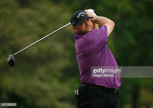 Jason Gore watches his drive on the ninth hole during the third round of the Webcom Tour Nationwide Children's Hospital Championship at The Ohio...