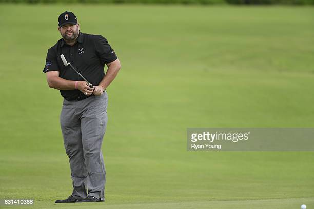 Jason Gore watches his putt on the 15th hole during the continuation of the second round of The Bahamas Great Exuma Classic at Sandals Emerald Bay...