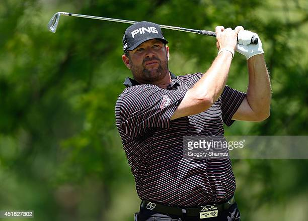 Jason Gore watches his tee shot on the fourth hole during the third round of the Webcom Tour Cleveland Open at the Lakewood Country Club on June 7...