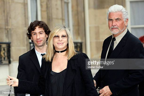 Jason Gould Barbra Steisand and James Brolin attend a formal ceremony at the Elysee Palace honoring Streisand with an induction into France's Legion...