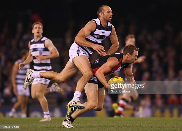 Jason Gram of the Saints and James Podsiadly of the Cats compete for the ball during the round 21 AFL match between the Geelong Cats and the St Kilda...