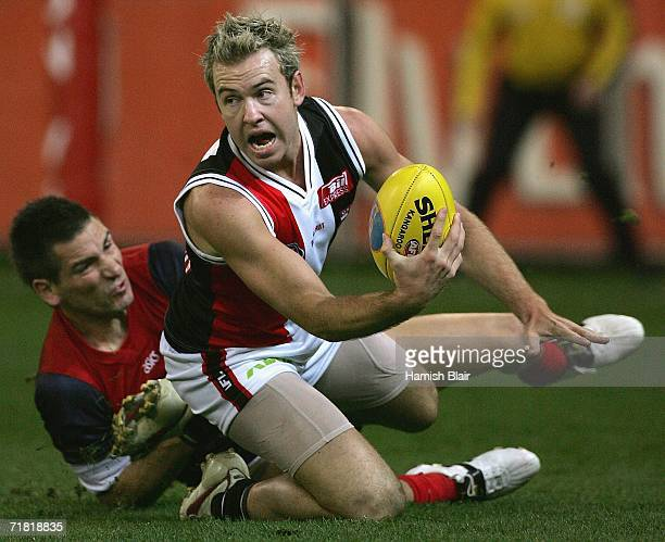 Jason Gram of the Saints contests the ball with Adem Yze of the Demons during the AFL Second Elimination Final between the St Kilda Saints and the...
