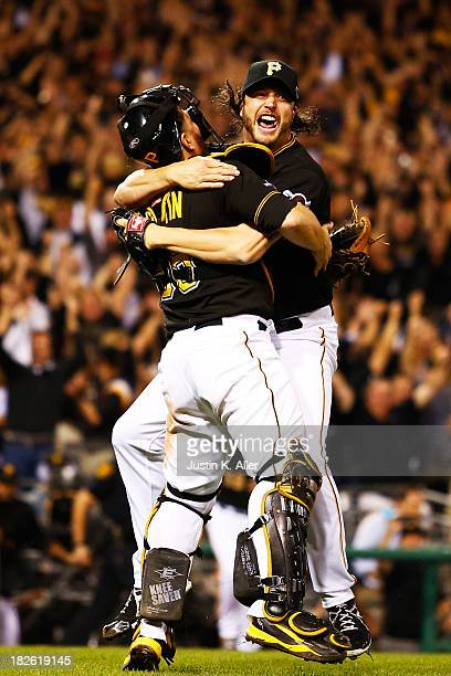 Jason Grilli and Russell Martin of the Pittsburgh Pirates celebrate their 6 to 2 win over the Cincinnati Reds during the National League Wild Card...