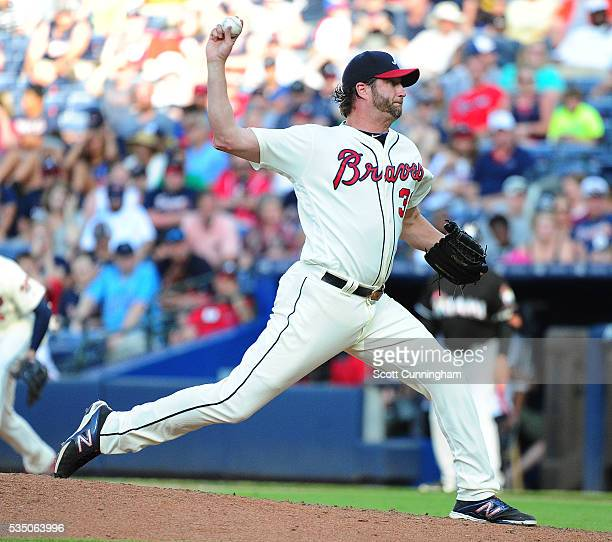 Jason Grilli of the Atlanta Braves throws an eighth inning pitch against the Miami Marlins at Turner Field on May 28 2016 in Atlanta Georgia