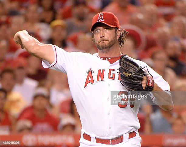 Jason Grilli of the Los Angeles Angels makes a throw to first during the fifth inning against the Seattle Mariners at Angel Stadium of Anaheim on...