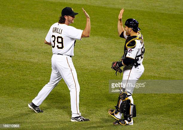 Jason Grilli of the Pittsburgh Pirates celebrates his 18th save against the Chicago Cubs during the game on May 21 2013 at PNC Park in Pittsburgh...