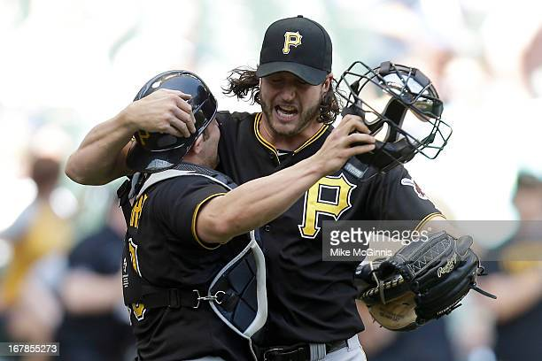 Jason Grilli of the Pittsburgh Pirates celebrates with Michael McKenry after the 64 win over the Milwaukee Brewers during the game at Miller Park on...