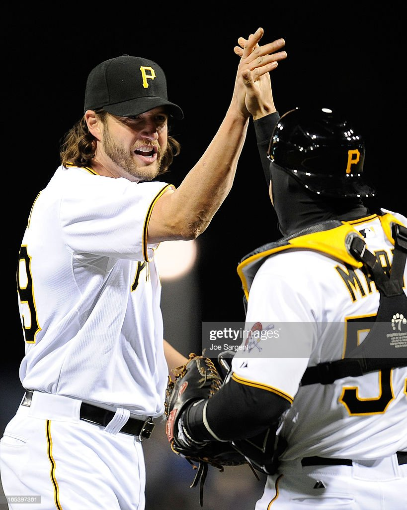 Jason Grilli #39 of the Pittsburgh Pirates celebrates with Russell Martin #55 after a 3-0 win over the Chicago Cubson April 3, 2013 at PNC Park in Pittsburgh, Pennsylvania.