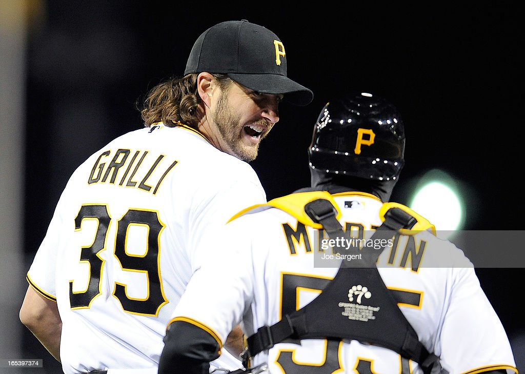 Jason Grilli #39 of the Pittsburgh Pirates celebrates with Russell Martin #55 after a 3-0 win over the Chicago Cubs on April 3, 2013 at PNC Park in Pittsburgh, Pennsylvania.