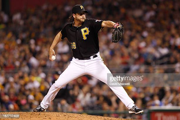 Jason Grilli of the Pittsburgh Pirates pitches against the Cincinnati Reds during the ninth inning of their game on September 21 2013 at PNC Park in...