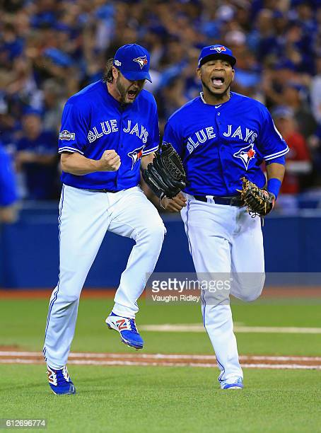 Jason Grilli of the Toronto Blue Jays and Edwin Encarnacion react after the third out in the eighth inning against the Baltimore Orioles during the...