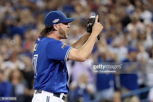 Jason Grilli of the Toronto Blue Jays reacts after closing out the top of the eighth inning against the Cleveland Indians during game four of the...