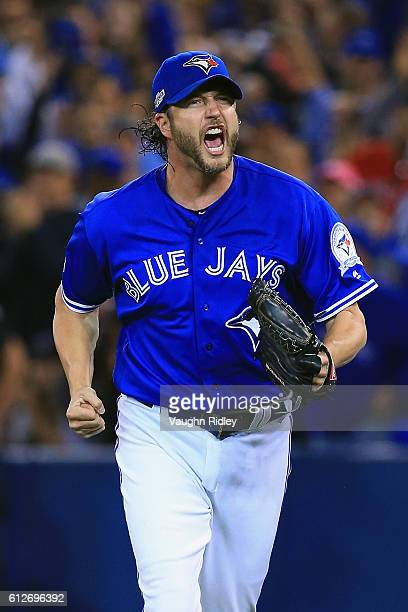 Jason Grilli of the Toronto Blue Jays reacts after the third out in the eighth inning against the Baltimore Orioles during the American League Wild...