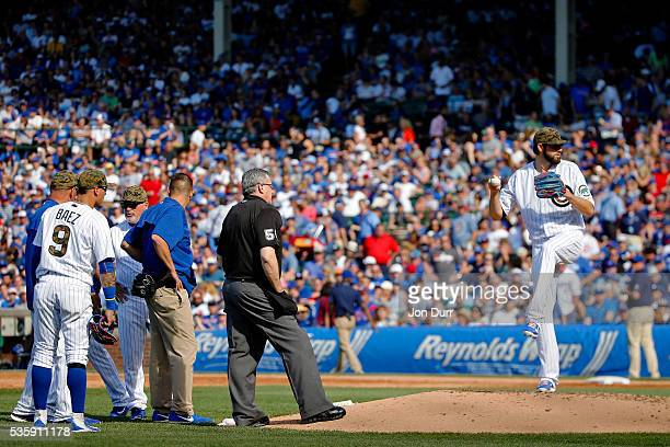Jason Hammel of the Chicago Cubs throws a few practice pitches after an injury before the start of the third inning against the Los Angeles Dodgers...