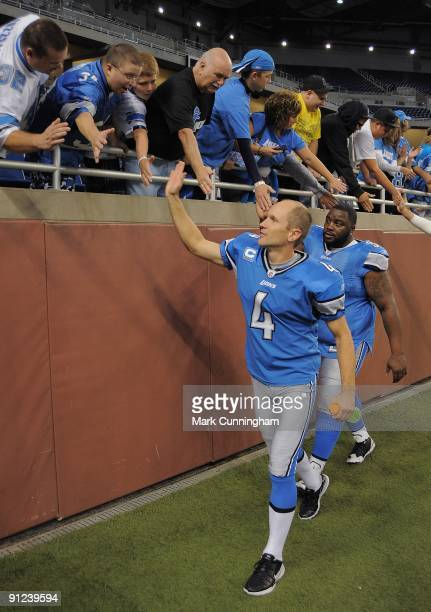 Jason Hanson and Grady Jackson of the Detroit Lions shake hands with fans after the victory against the Washington Redskins at Ford Field on...