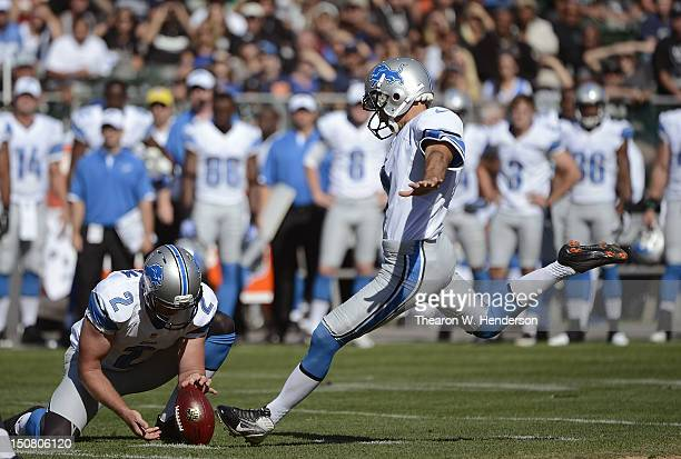 Jason Hanson of the Detroit Lions attempts a field goal with Ben Graham doing the holding against the Oakland Raiders during the first quarter of an...