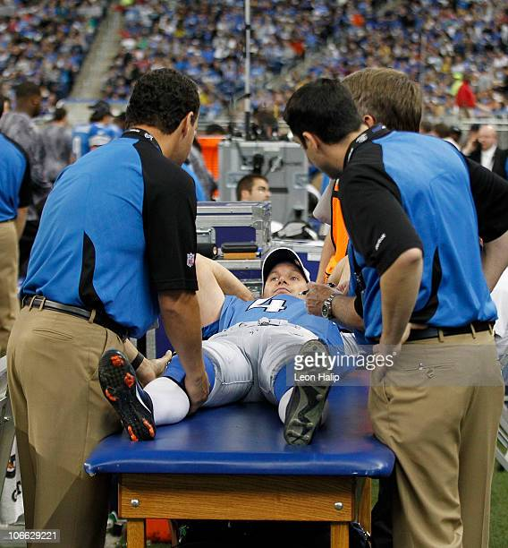 Jason Hanson of the Detroit Lions gets checked out by the team doctors after a collission with Trevor Pryce of the New York Jets during the game at...