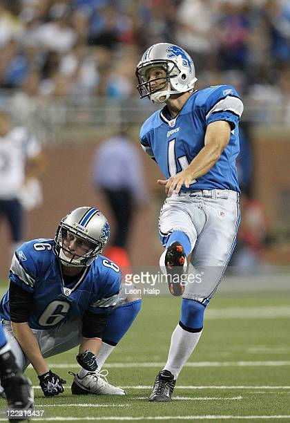 Jason Hanson of the Detroit Lions kicks a 33 yard field goal in the first quarter during the pre-season game against the New England Patroits at Ford...