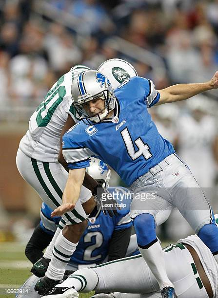 Jason Hanson of the Detroit Lions reacts after getting hit by Trevor Pryce of the New York Jets during the game at Ford Field on November 7, 2010 in...
