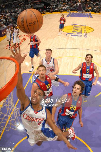 Jason Hart of the Los Angeles Clippers puts up a shot while teammate Paul Davis and David Anderson Victor Sada and Gianluca Basile of Regal FC...