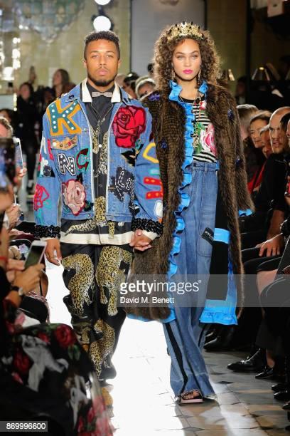 Jason Harvey and Amanda Harvey walk the Dolce Gabbana Italian Christmas catwalk show at Harrods on November 2 2017 in London England