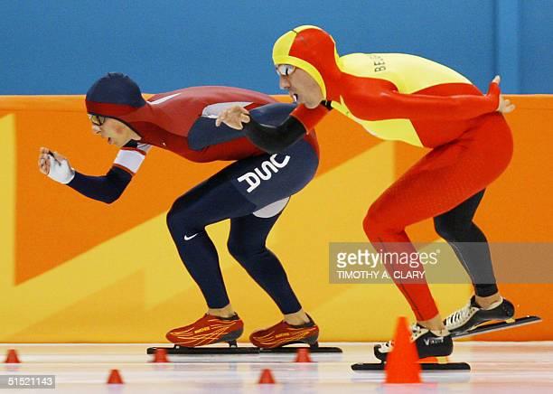 Jason Hedstrand and Belgian Bart Veldkamp skate in the men's 10000m speedskating race at the Utah Olympic Oval 22 February 2002 during the XIXth...