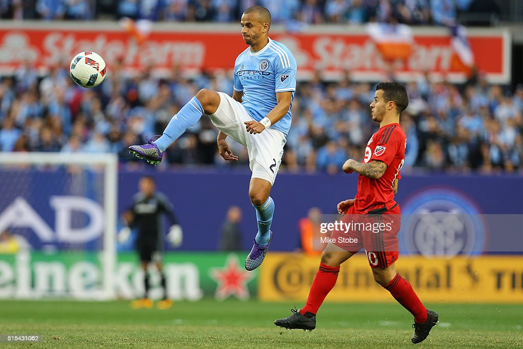 Jason Hernandez #2 of New York City FC plays the ball in front of Sebastian Giovinco #10 of Toronto FC at Yankee Stadium on March 13, 2016 in the Bronx borough of New York City.